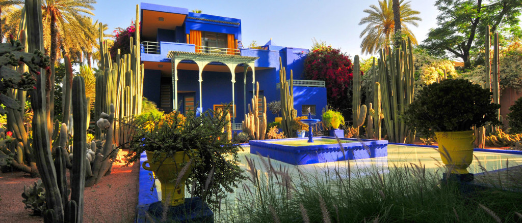 Jardin Marjorelle, Marrakesh, Morocco. The high chroma ultramarine blue painted Art Deco style villa and surrounding gardens of Jardin Marjorelle designed by Jacques Marjorelle in the early 1930′s and lovingly restored by Yves Saint Laurent and Pierre Bergé in 1980